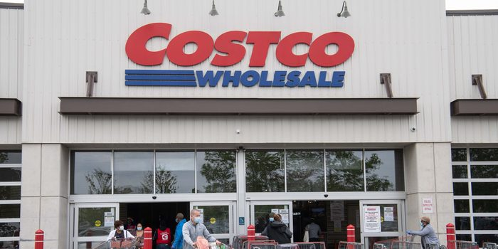 Shoppers walk out with full carts from a Costco store in Washington, DC, on May 5, 2020. - Big-box retailer Costco is limiting consumer purchases of meat in the wake of shutdowns of US processing plants due to the coronavirus.Costco, which has about 440 stores in the United States, is limiting purchases to three items among beef, pork and poultry products, the company said on its website. (Photo by NICHOLAS KAMM / AFP) (Photo by NICHOLAS KAMM/AFP via Getty Images)