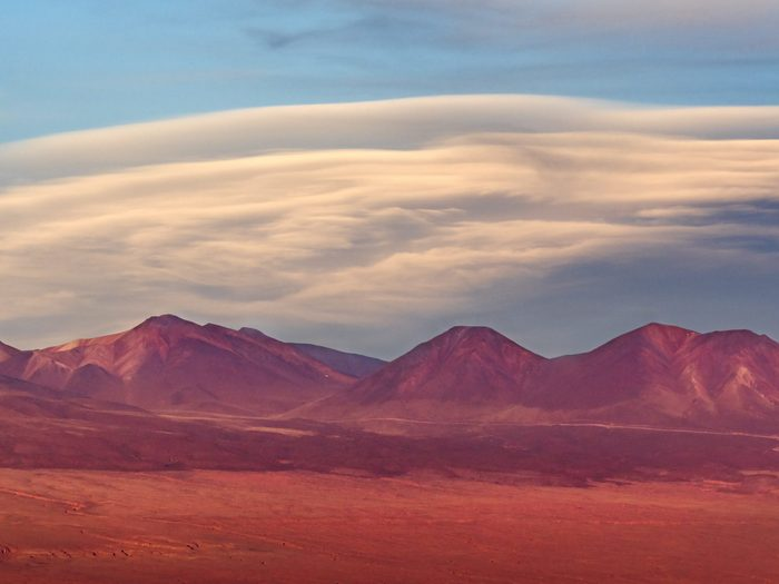 Lenticular cloud formation over the Valley of the Moon in Chile