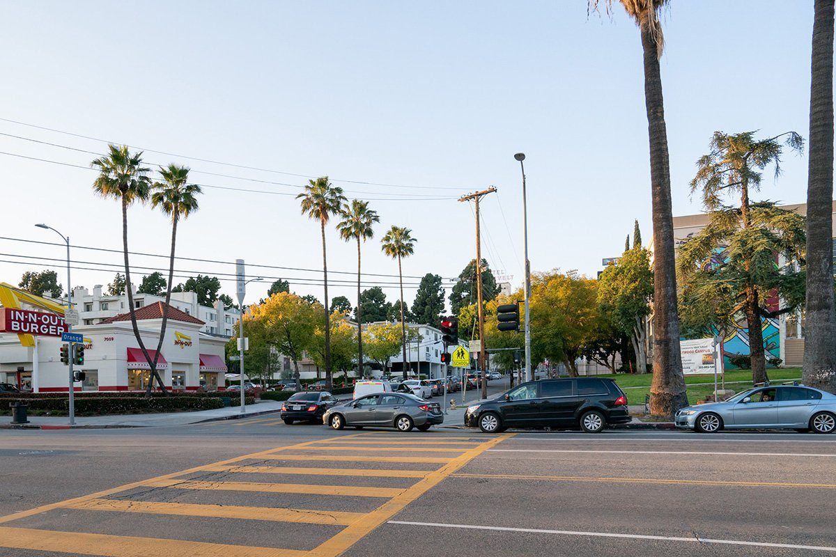 LOS ANGELES, CA - MARCH 26: A general view of the Hollywood In-N-Out Burger on Sunset Blvd during the evening dinner rush, where cars will wait up to an hour to receive drive-thru service after the 'Safer at Home' emergency order was issued by L.A. authorities amid the ongoing threat of the coronavirus outbreak on March 26, 2020 in Los Angeles, California. The World Health Organization declared coronavirus (COVID-19) a global pandemic on March 11th. (Photo by AaronP/Bauer-Griffin/GC Images)