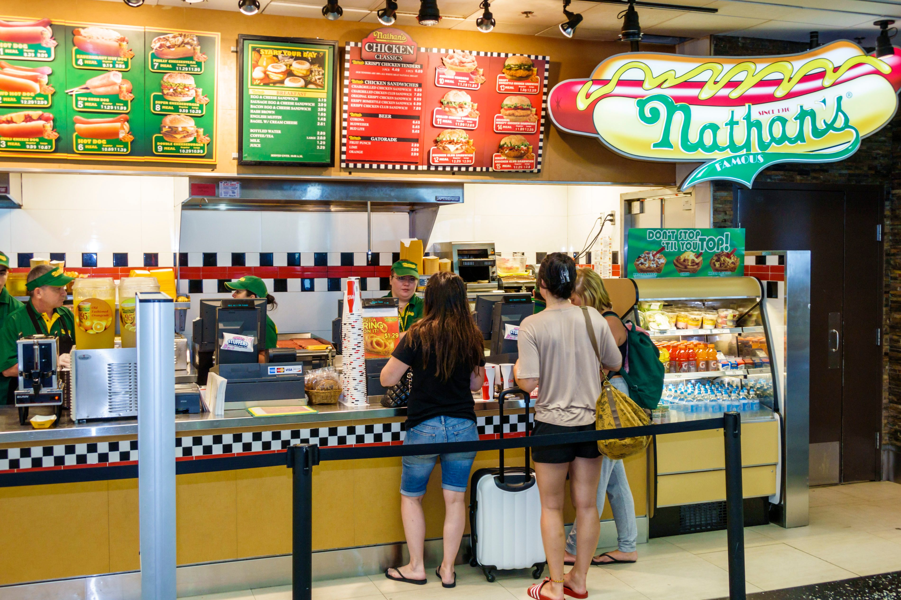 Nathan's Famous fast food hot dogs concession counter inside Miami International Airport.
