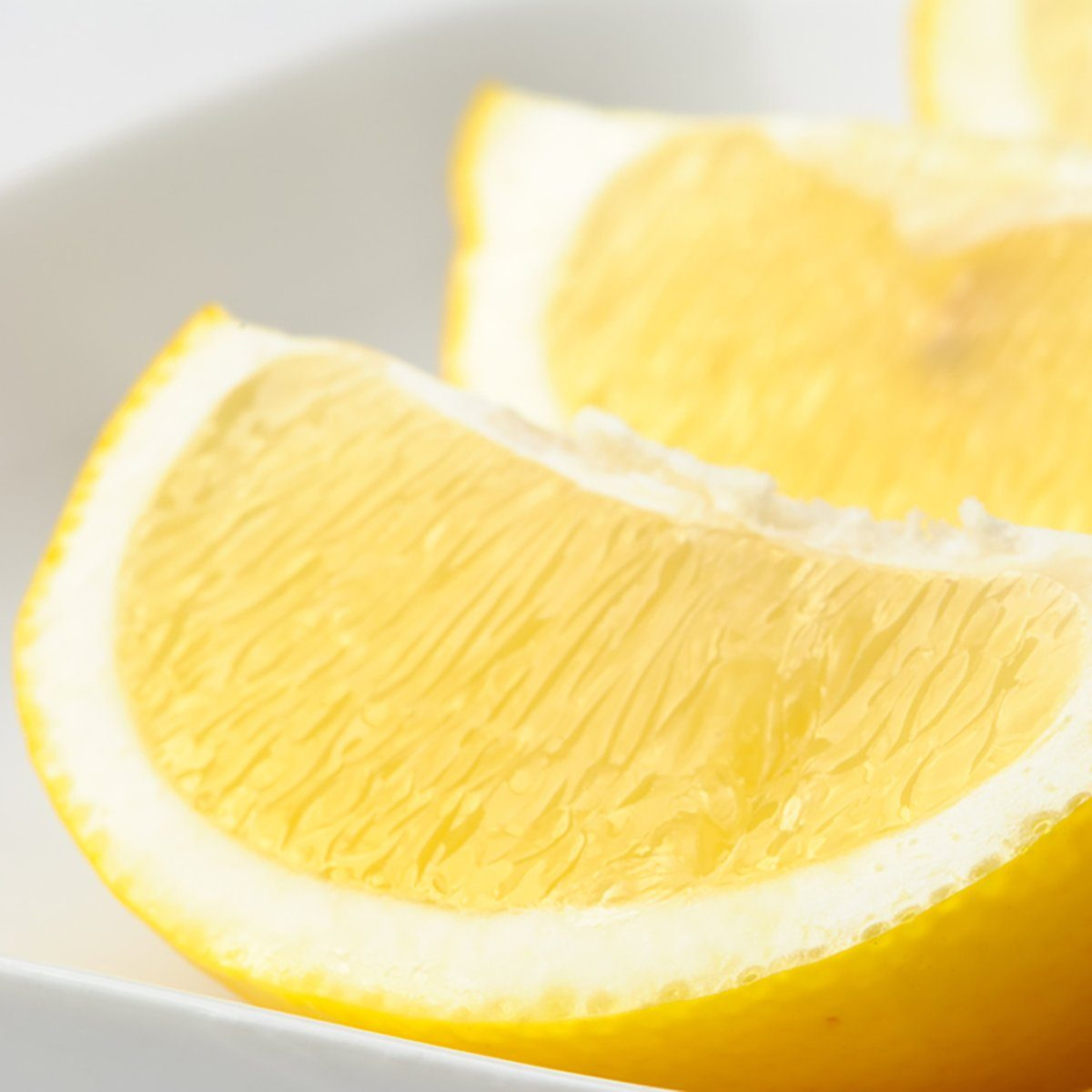 Lemon wedges in a white dish
