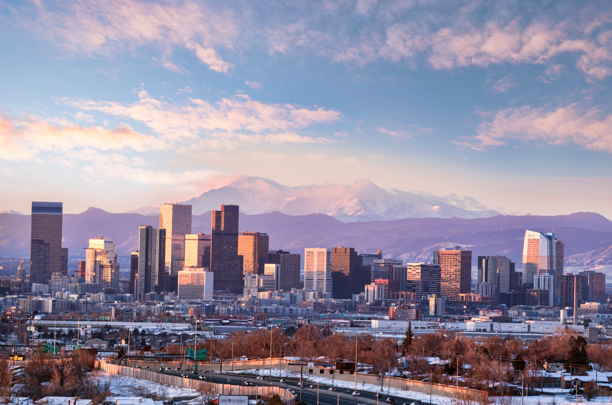 denver cityscape with moutains in the background