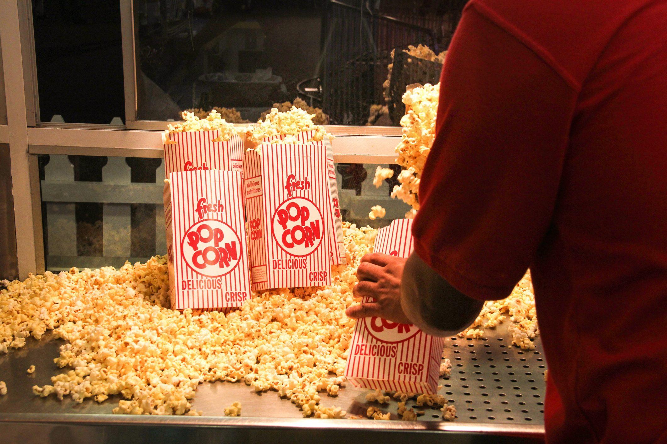 Popcorn vendor inside a concession stand