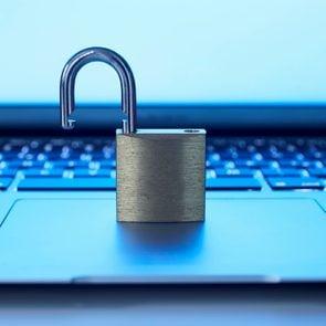 Still life of laptop and padlock, data security
