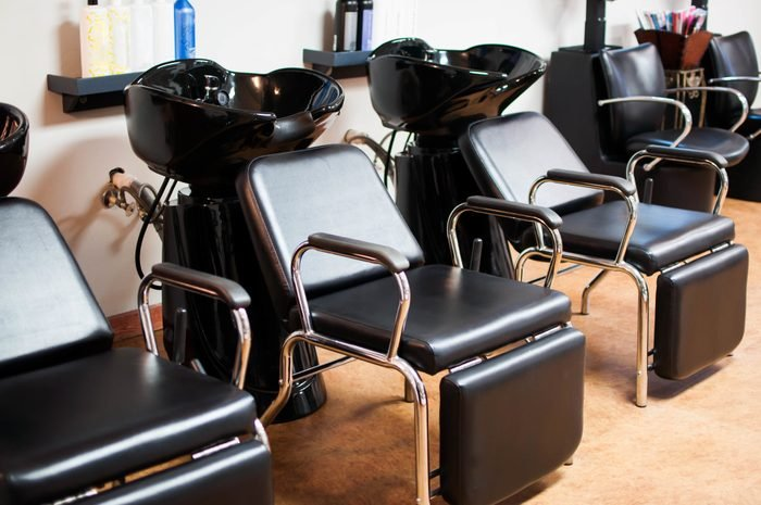 Chairs By Sink Bowl At Hair Salon