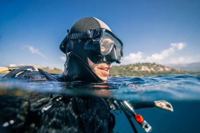 Scuba diver at sea surface