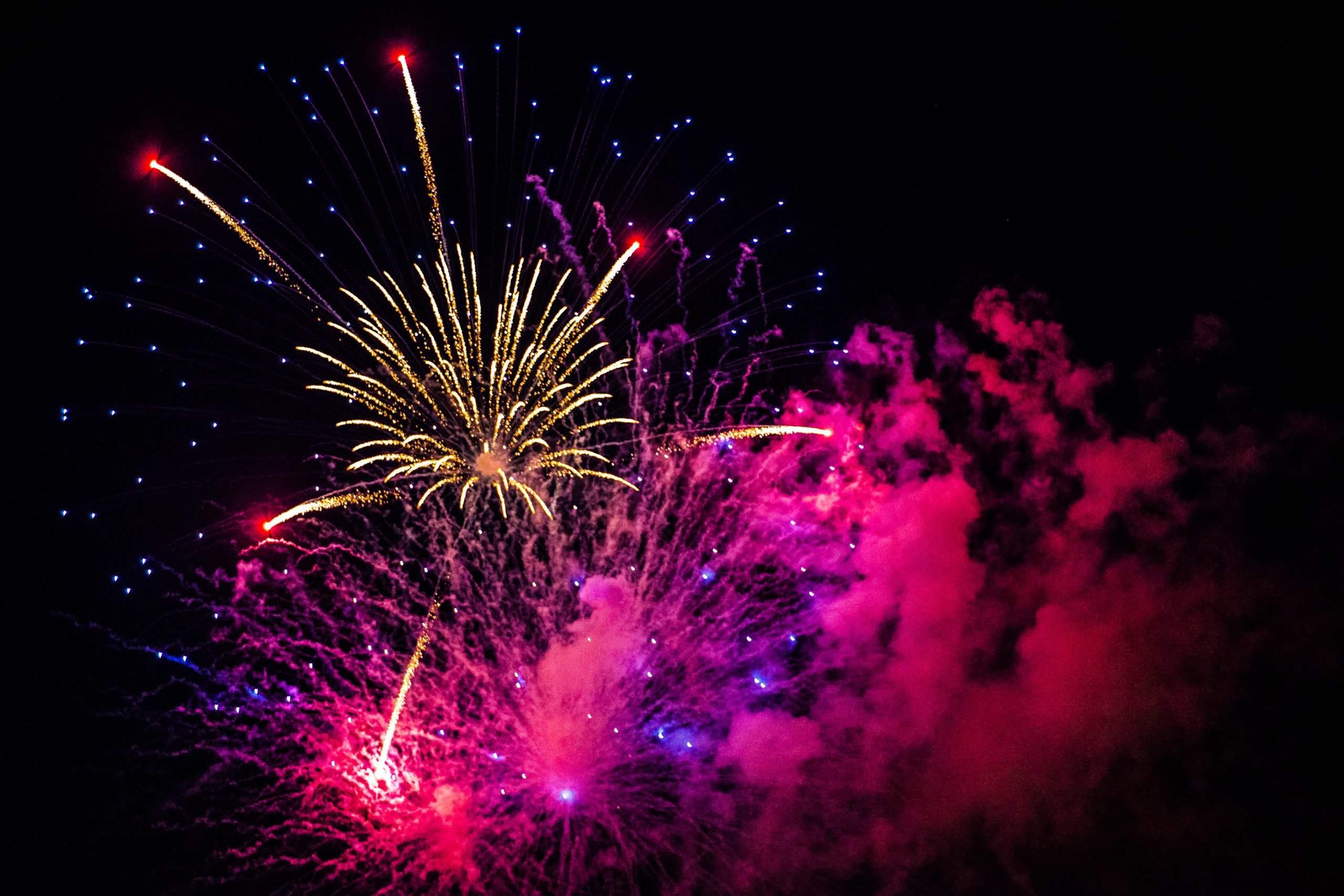 Pink, purple, and white Fourth of July fireworks