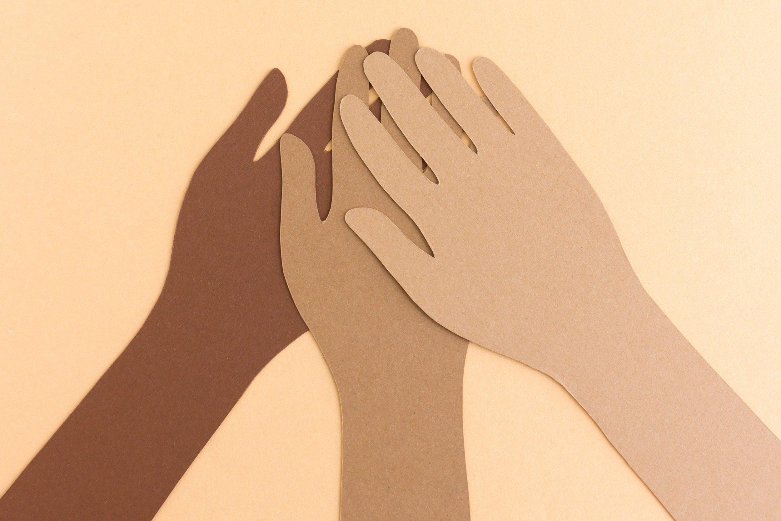 paper cutouts. diverse hands. bipoc.