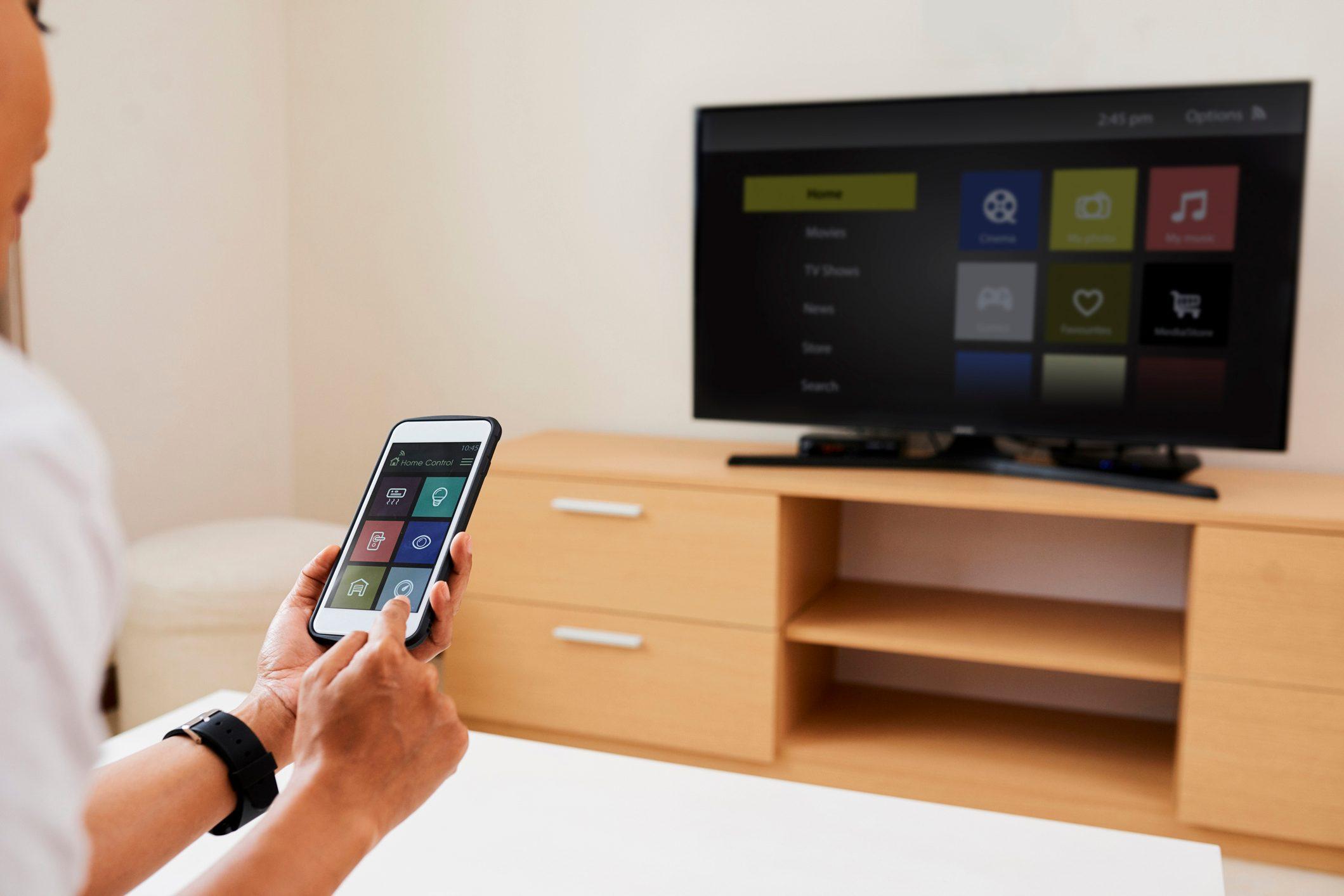 Woman choosing a programme on TV