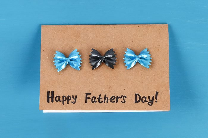 Diy greeting card father day pasta form bow tie blue background. Gift idea, decor Father day, Daddy.