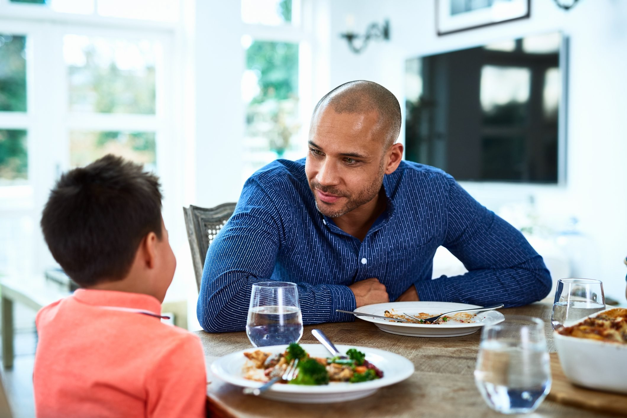 Father talking to son at dinner table