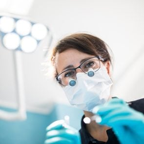 Dentist treating patient in medical clinic
