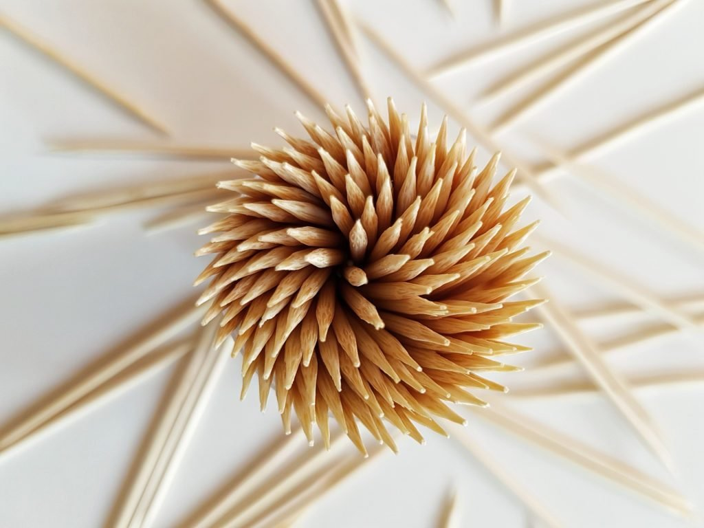 Directly Above Shot Of Toothpicks Over White Background