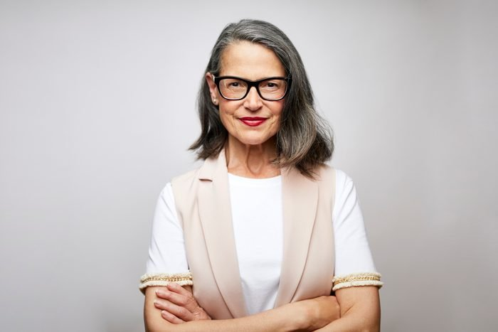 Mature female CEO with arms crossed