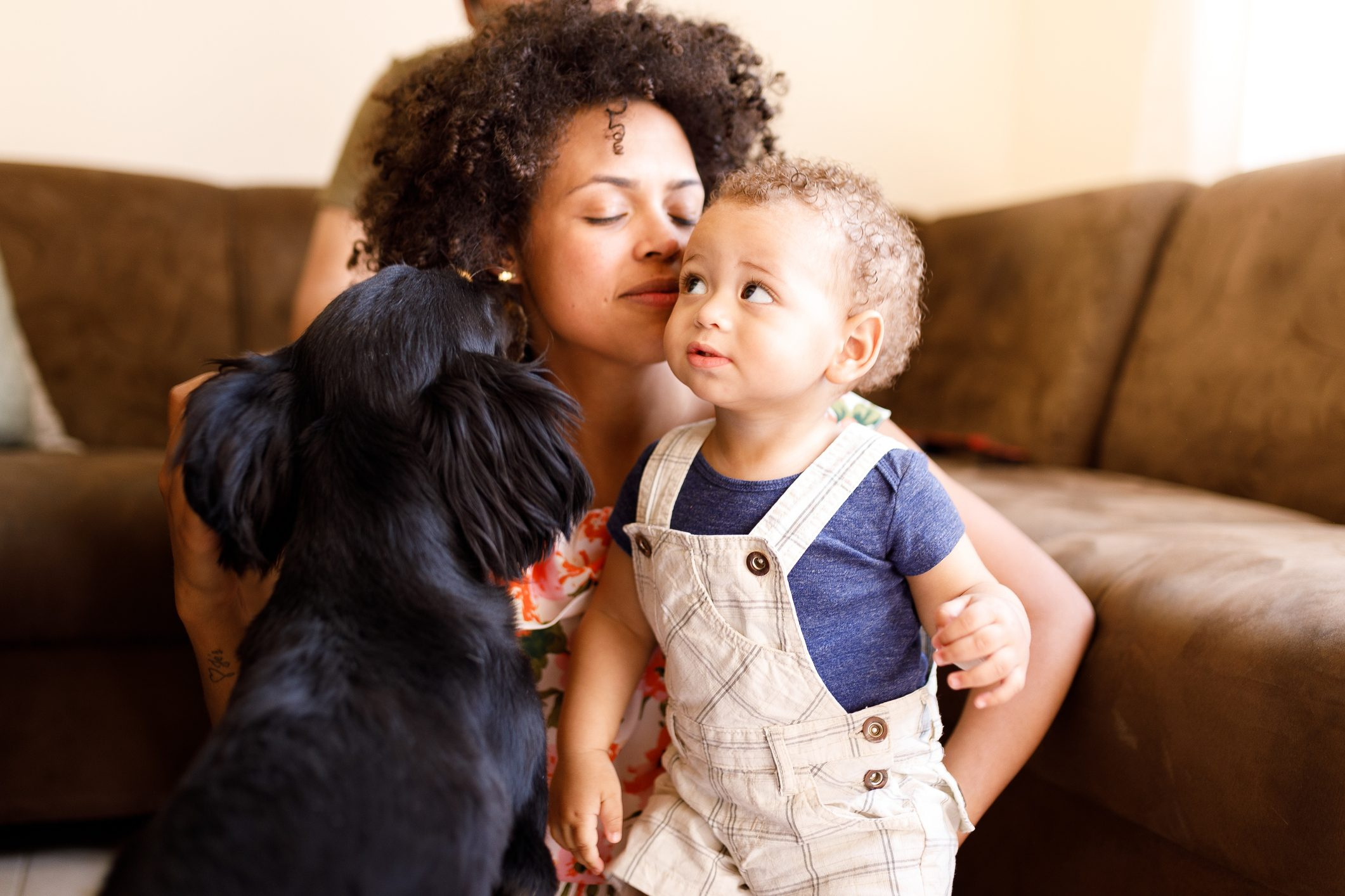 Woman, baby and dog showing affection