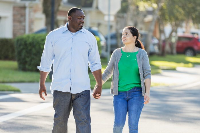 Happy interracial couple taking a walk