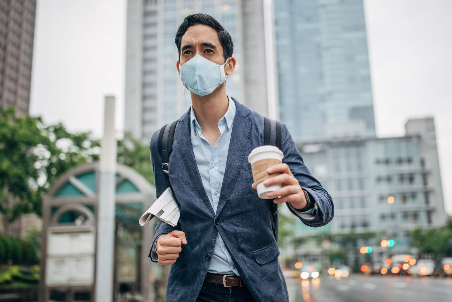 Gentleman with pollution mask in coronavirus infected city downtown