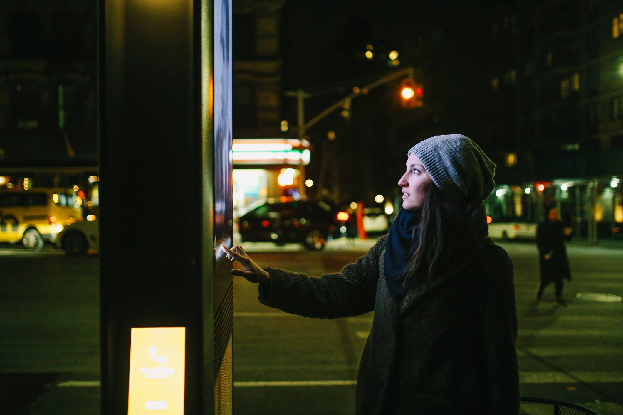 Woman using touch screen city display