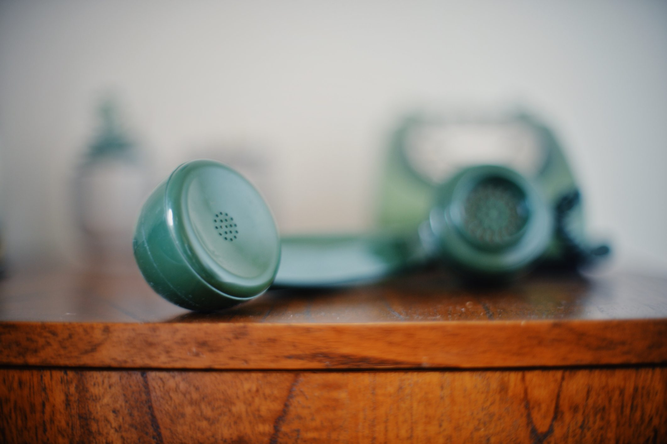 Old green telephone handset receiver