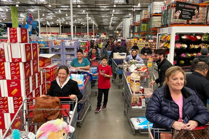Stores feel the rush of shoppers stocking up in the midst of a pandemic