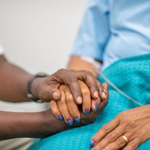 close up of hands holding in hospital