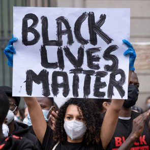 A protester holds a placard saying Black Lives Matter during...
