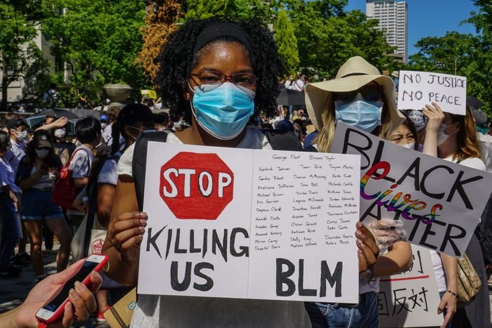 A protester holding a BLM placard during the demonstration.