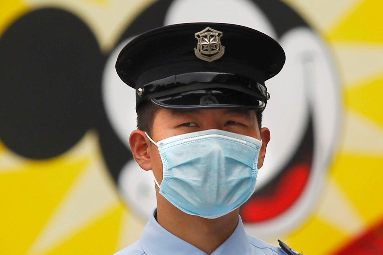 Disney Castmember wearing a mask