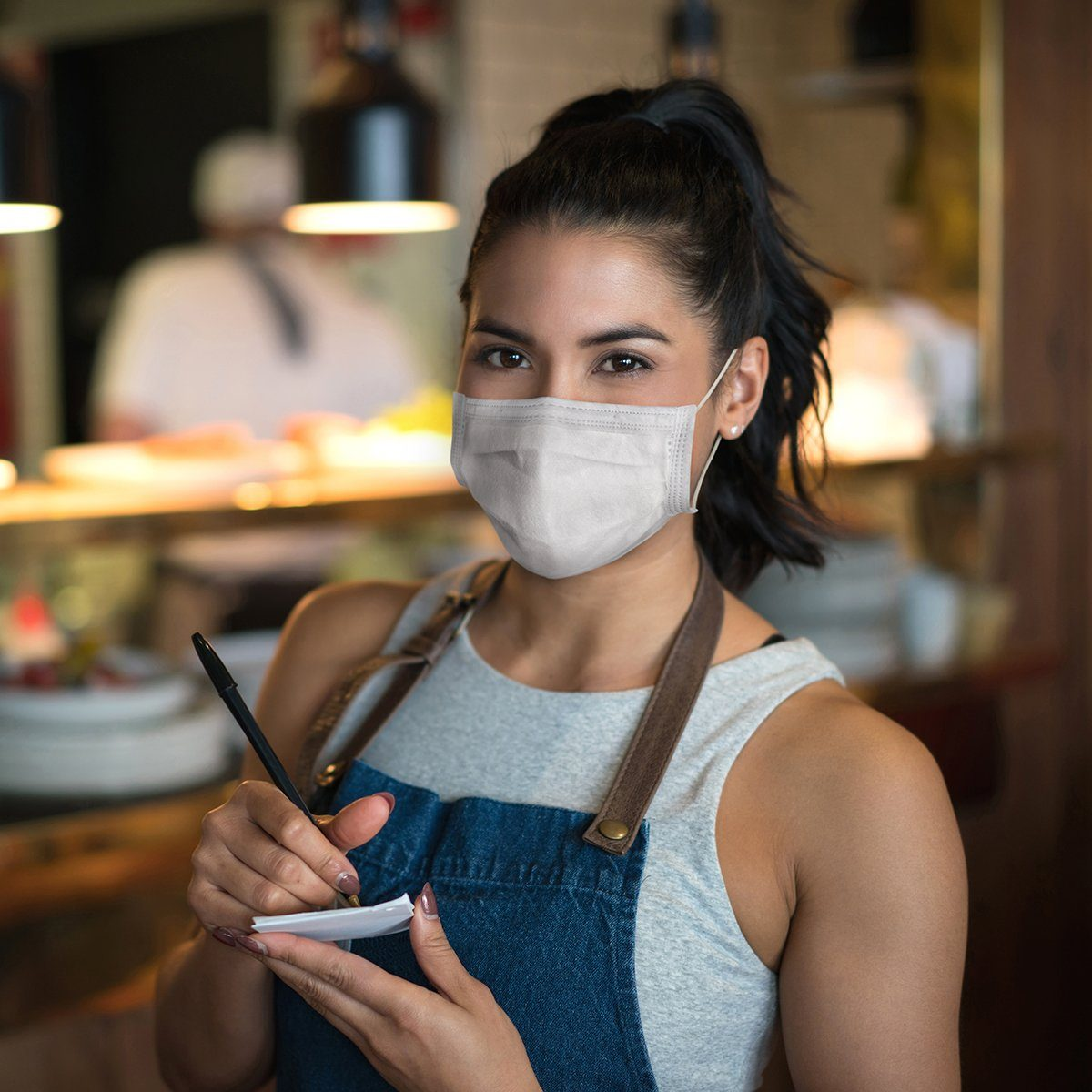 waitress holding pad and pen