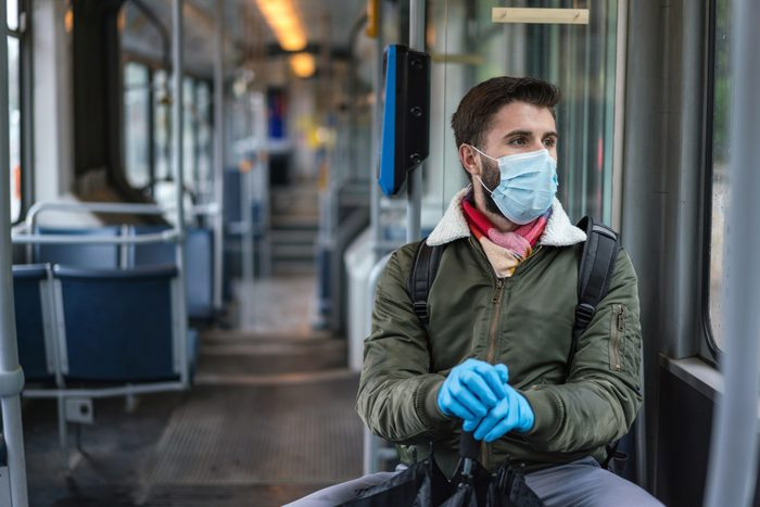 Man travelling alone in the empty city tram during Covid-19 quarantine
