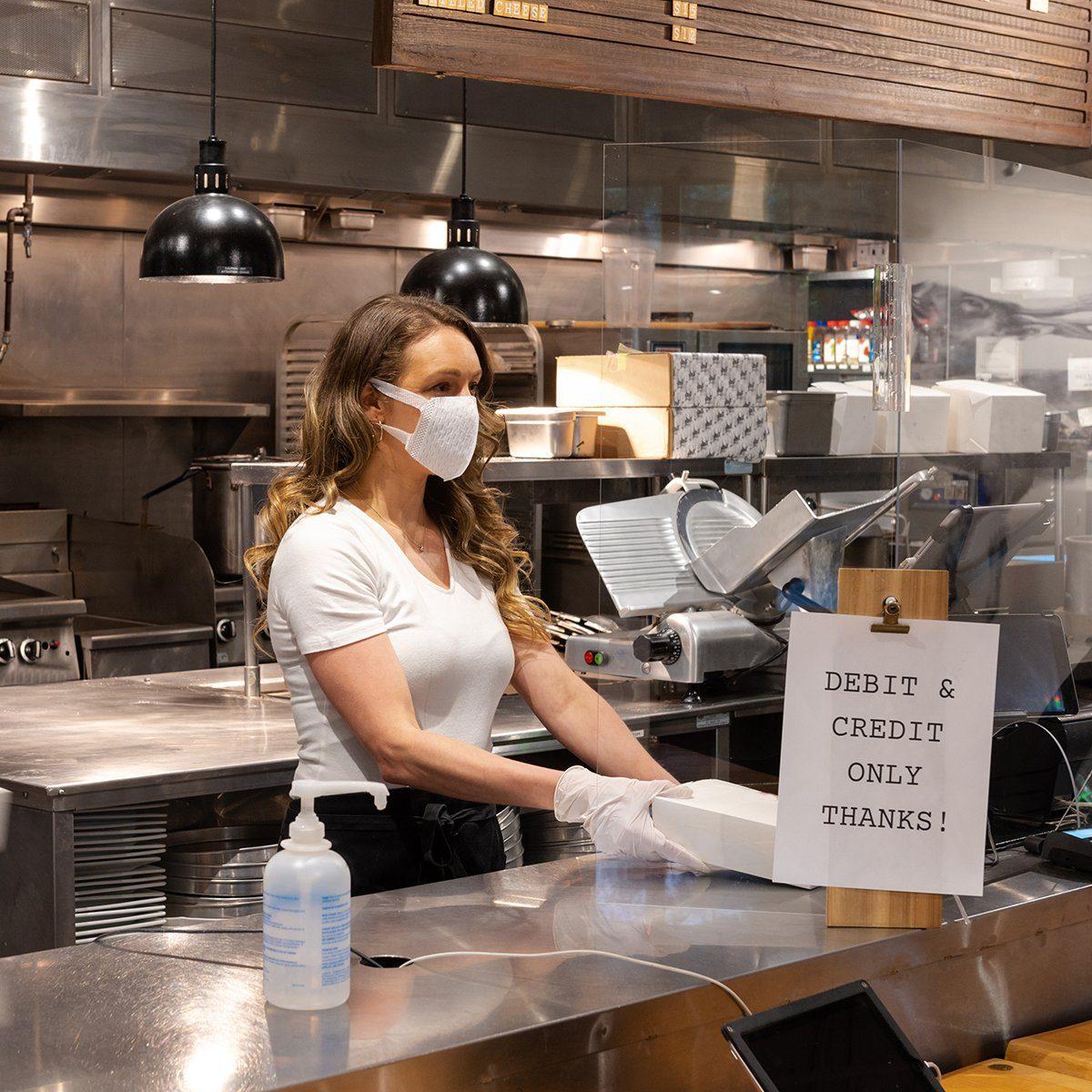 woman working in a restaurant kitchen