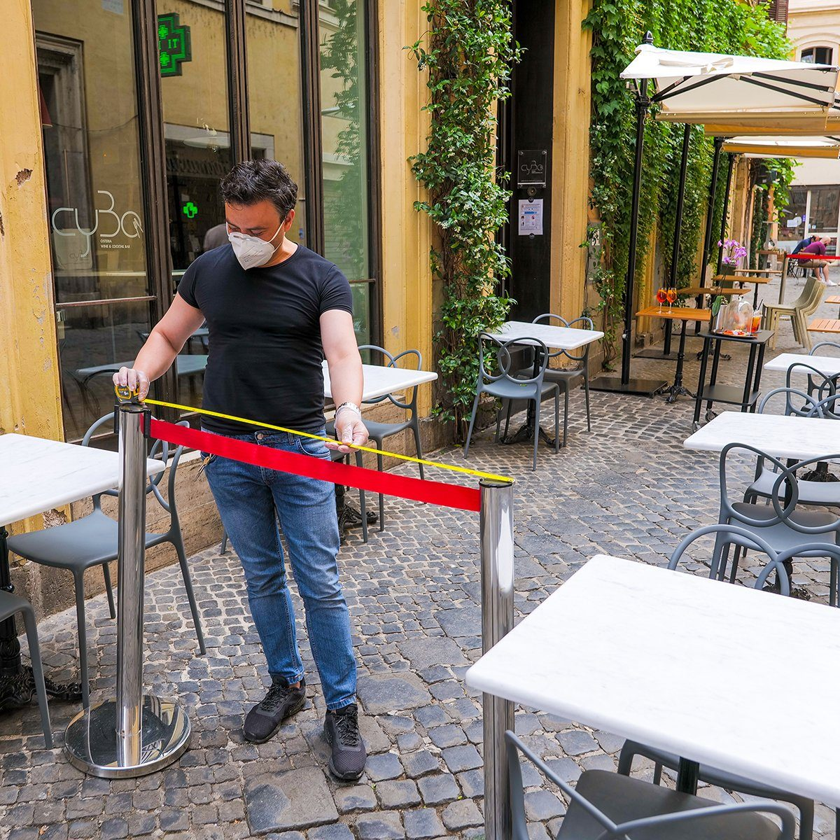 restaurant worker measuring