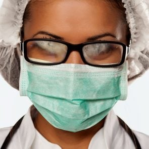 doctor wearing mask with foggy glasses