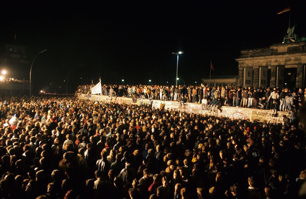 Germany / GDR, Berlin. The fall of the wall. People at the Brandenburg Gate. 13.11.1989