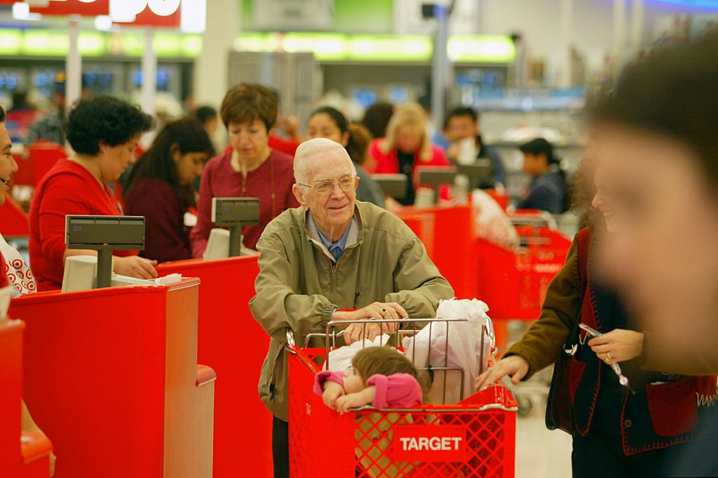Robert Shuss of Glendale leaving the checkout line as shoppers try to take advantage of bargains at
