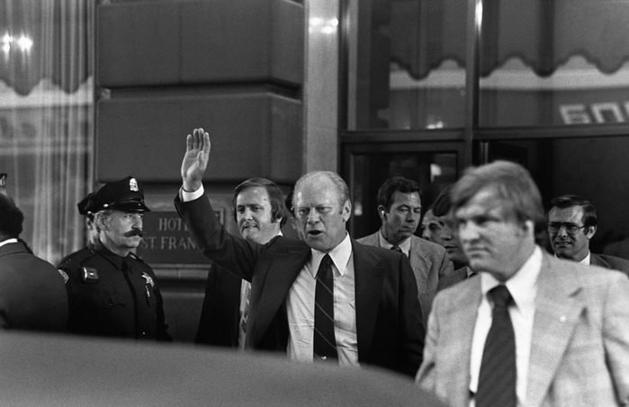 President Gerald Ford waves moments before shots were fired by Sara Jane Moore.