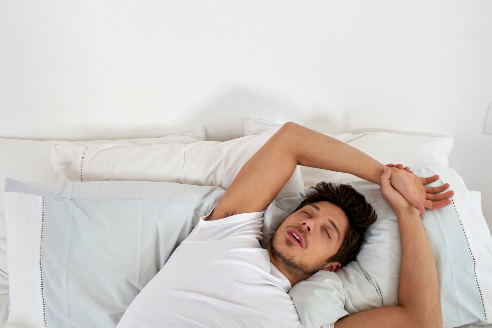up view of man sleeping in bed