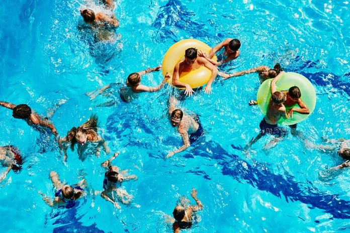 Group of kids playing together in outdoor pool