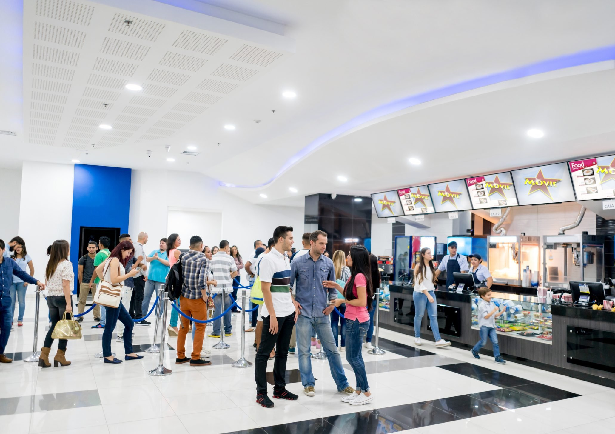 People buying food at the cinema before watching a movie