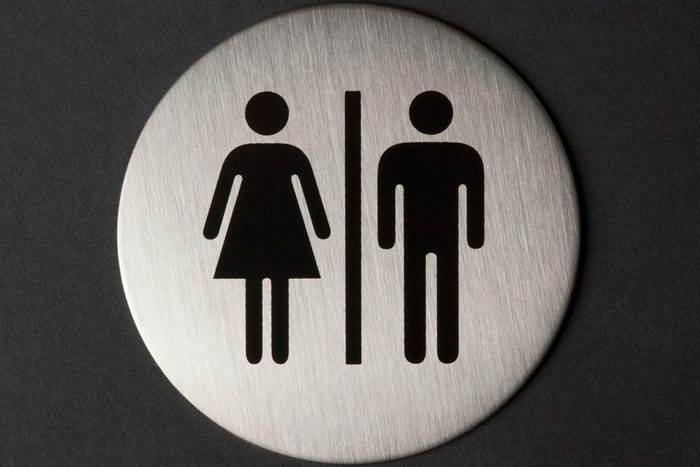 Female and male sign on toilet door