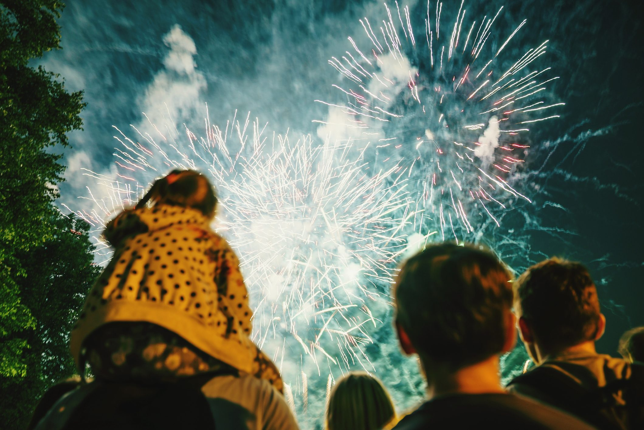 Low Angle View Of People Watching Firework Display