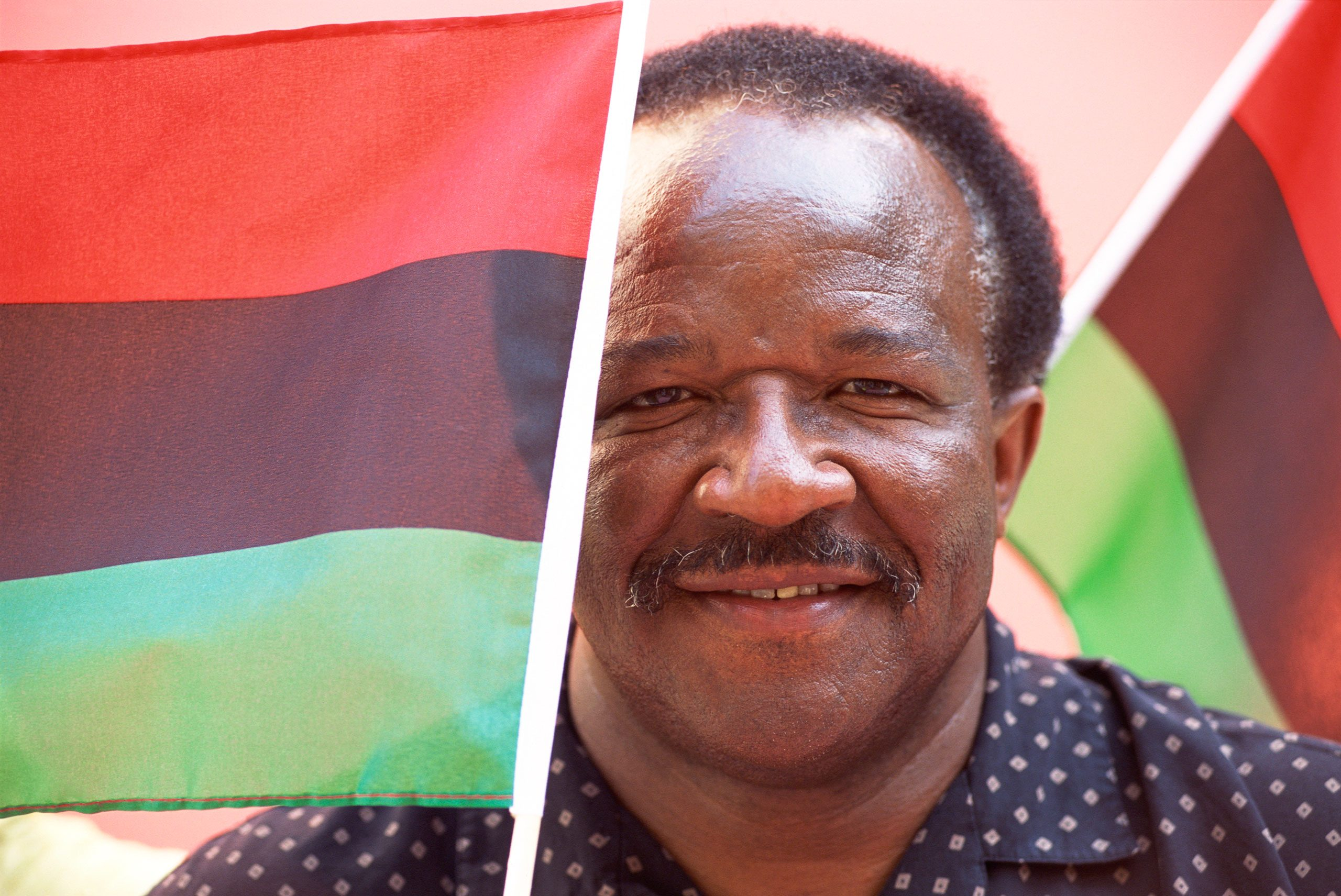 man with pan-african flags