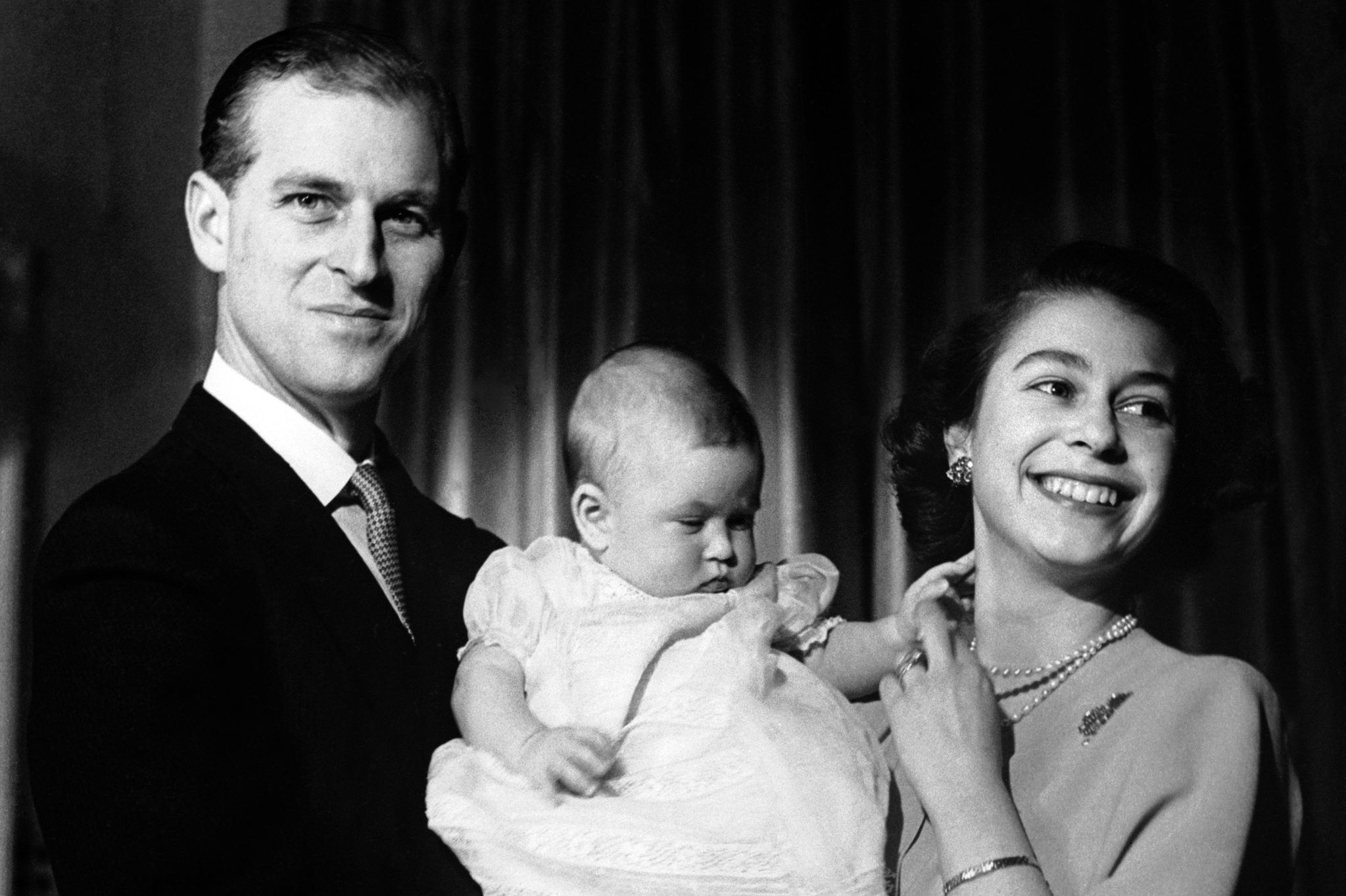 Royalty - Princess Elizabeth and Duke of Edinburgh with Prince Charles - Buckingham Palace, London