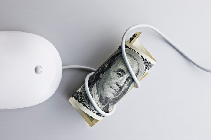 100 us dollar bill and computer mouse
