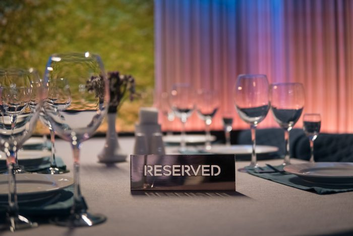 set of shiny wineglasses in restaurant;