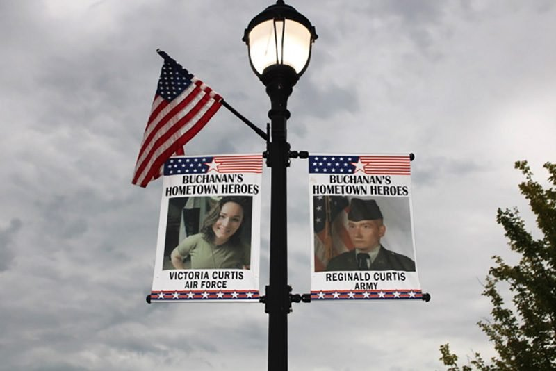 signs honoring veterans and a flag