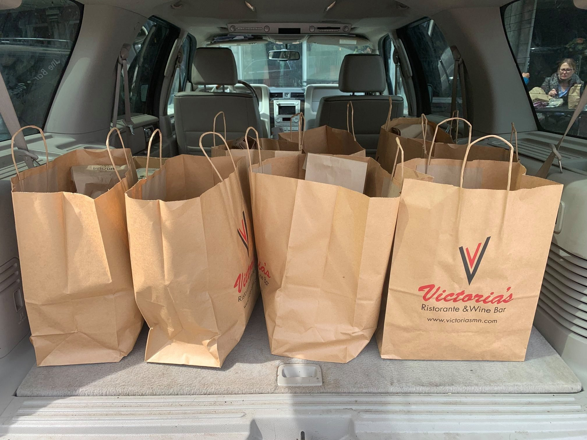 victoria's bags in the back of an suv
