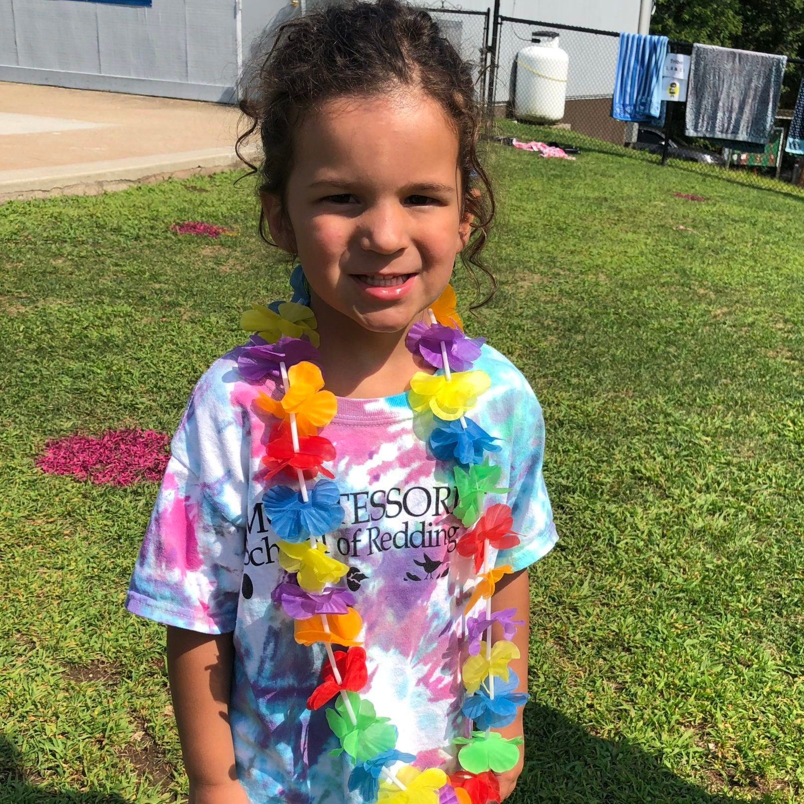 Lei-wearing kid at camp