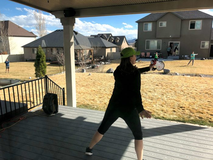 Heather Doney leading a zumba class from her back porch