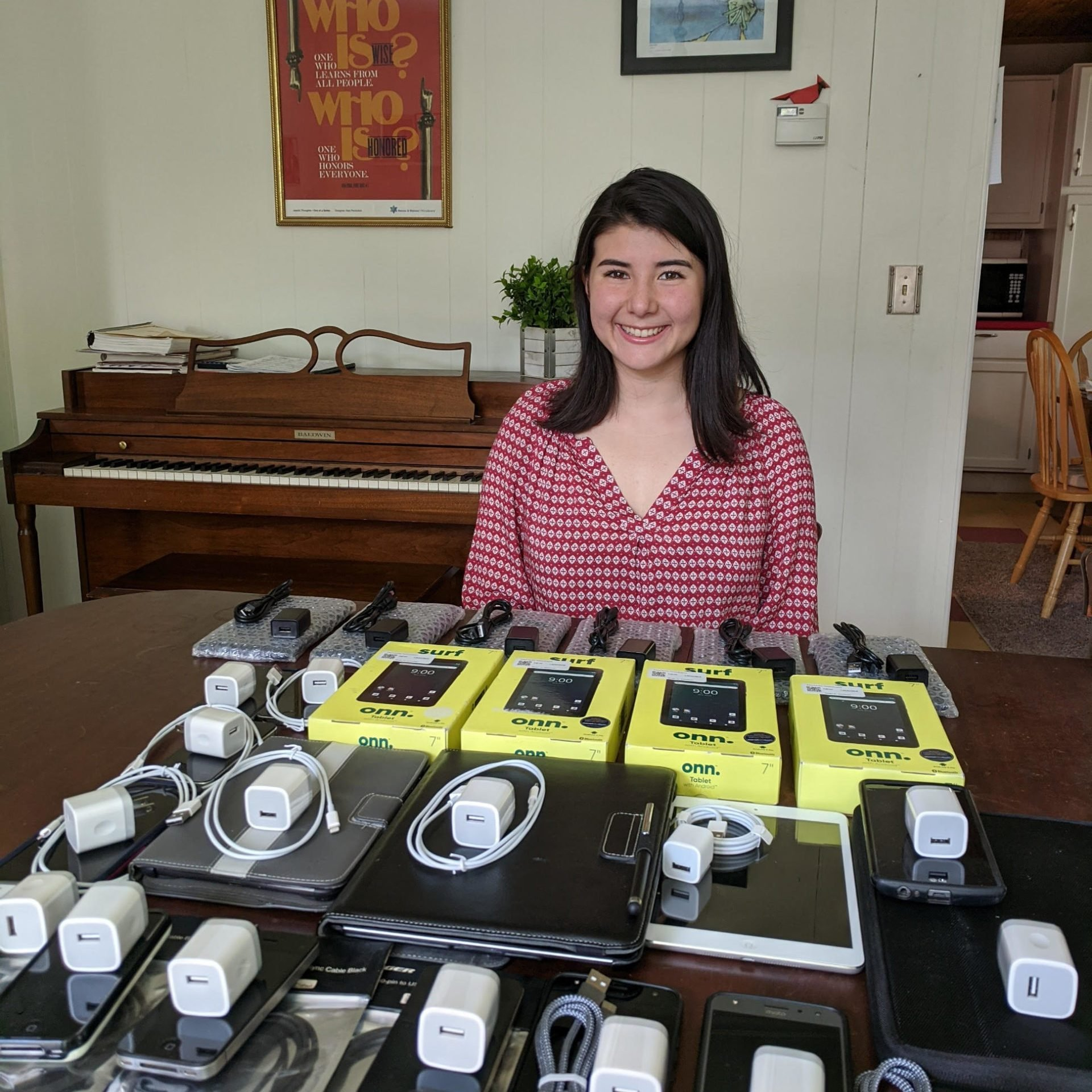 lia rubel posing with an array of collected devices